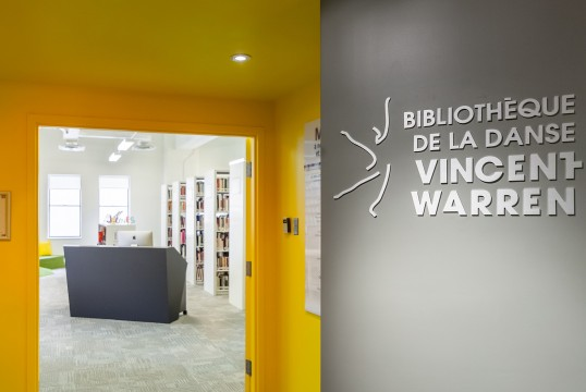Lobby of the bibliothèque de la danse Vincent-Warren with logo